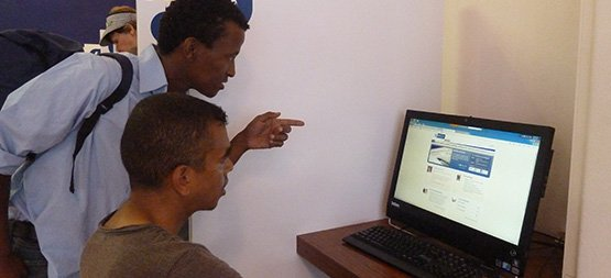 people looking at a website