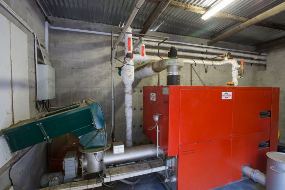 This biomass furnace, which runs on wood chips from a local sawmill, generates chilled water through a heat exchange process, which is used to control fermentation temperatures in the wine cellar, at Backsberg wine Estate.