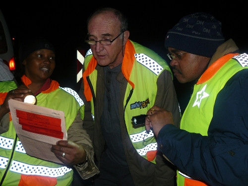 MEC The MECs inspecting an operating licence and finding that it has expired and that the vehicle is not allowed to operate on the route.