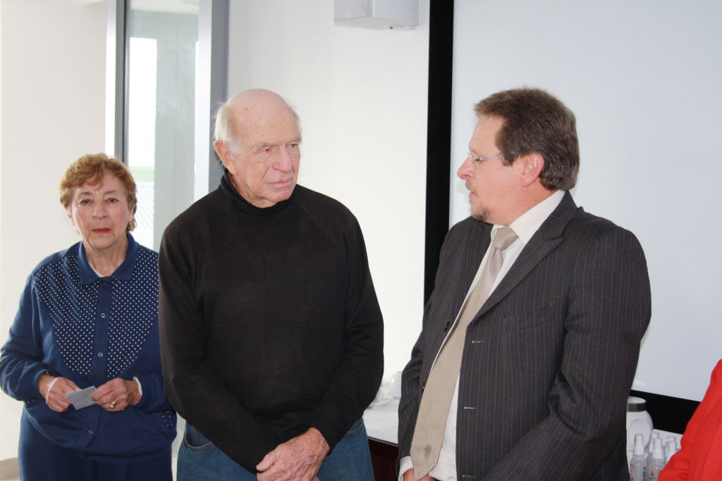 Minister Botha chatting with Mr and Mrs Jack Symons, satisfied patients of Hermanus Hospital.