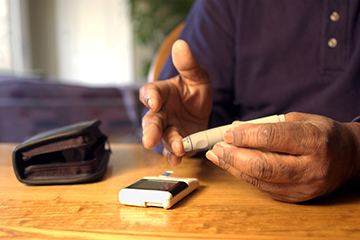 a man taking his blood sugar levels
