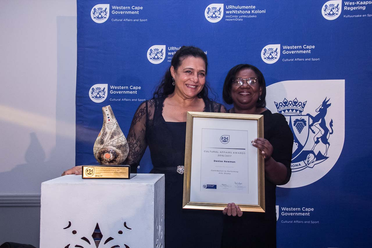 Actress Denise Newman receives her 2016/17 Cultural Affairs Award from Director Jane Moleleki