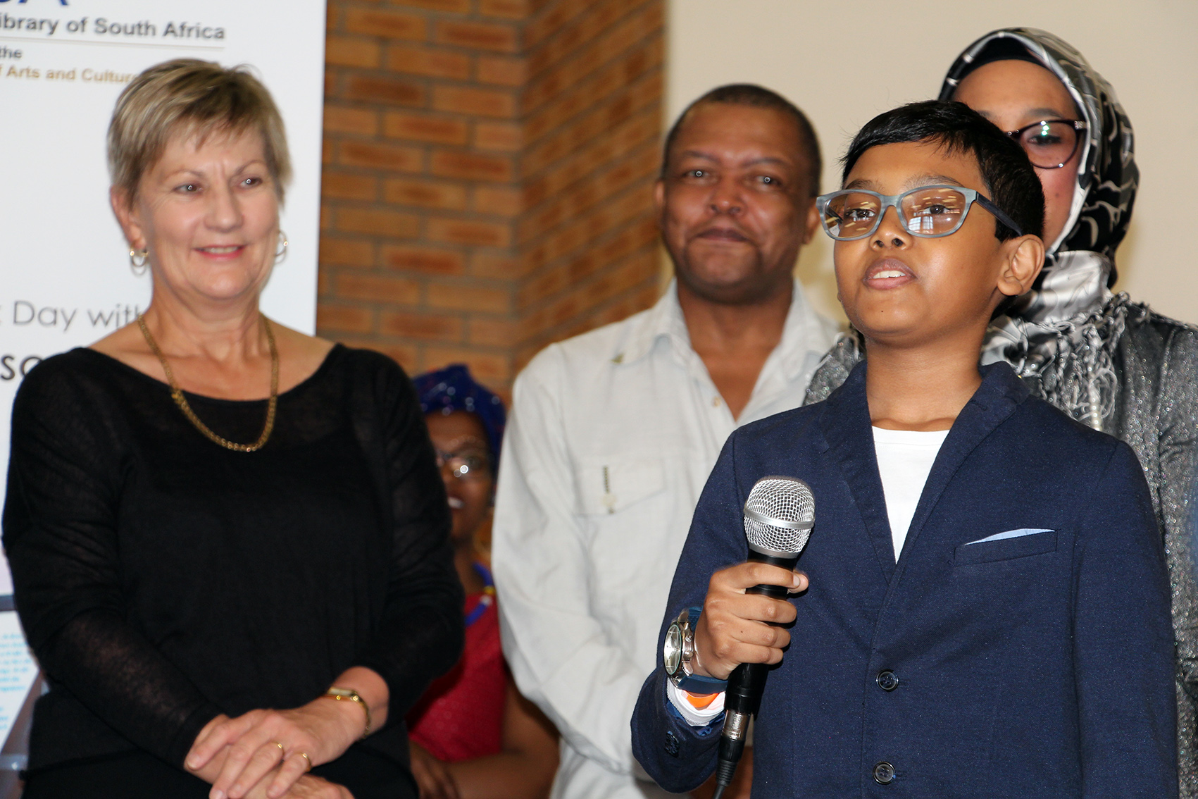Amr Salie gave an inspirational talk about books and how they changes his life while Minister Anroux Marais looked on