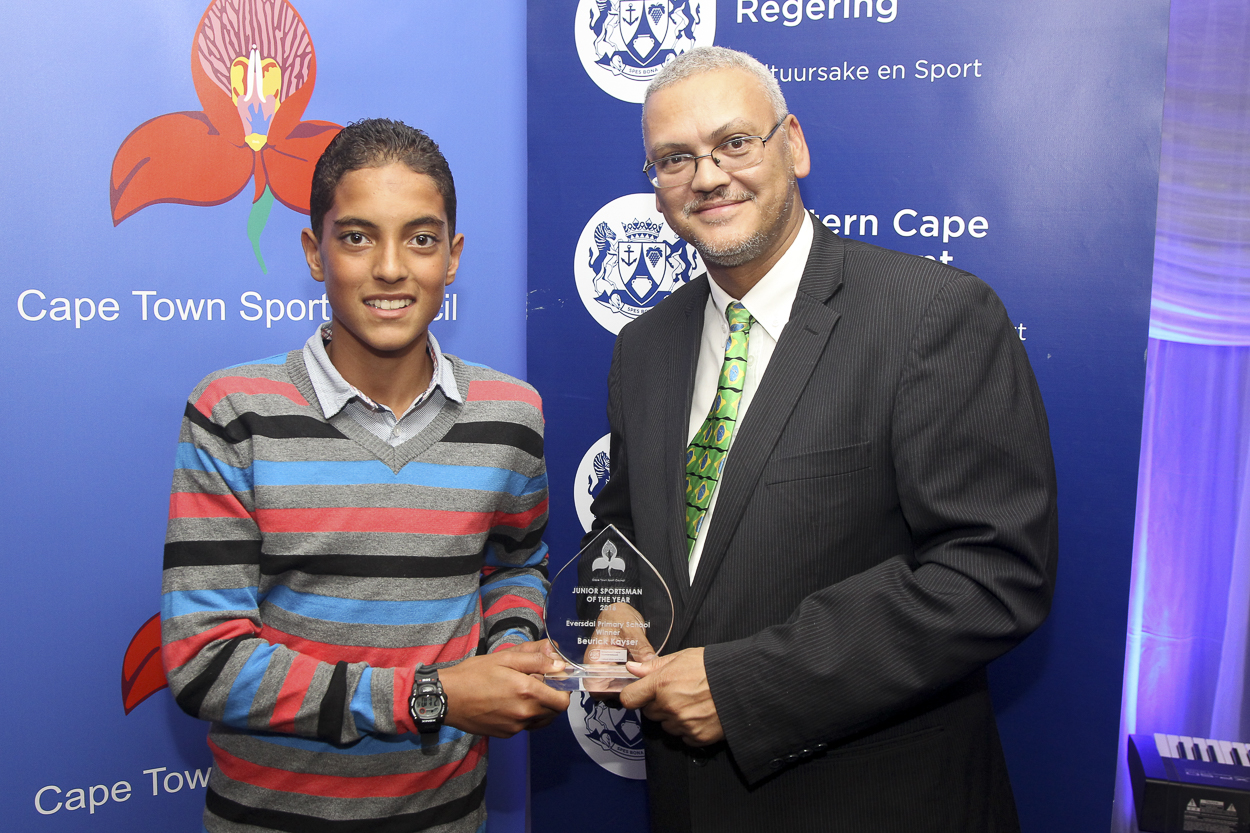 Beurick Kayser receives the Junior Sportsman of the Year award from Dr Bouah