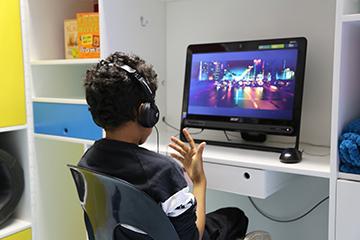Boy looking ata computer screen