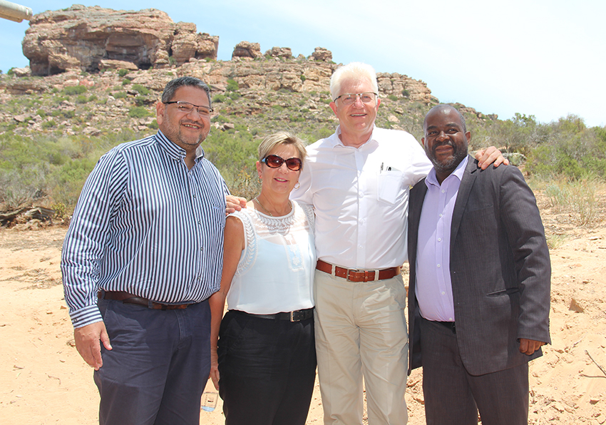 Brent Walters, DCAS head of department, Minister Anroux Marais, Western Cape Premier Alan Winde and Dr Mxolisi Dlamuka stand in front of the Diepkloof Rock Shelter (top left) after Monday's launch