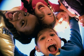 child-protection-week-kids-looking-into-camera.jpg