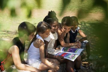 Children reading together after school