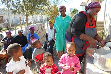 Community members feeding the hungry.