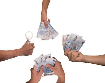 Hands holding money and a globe