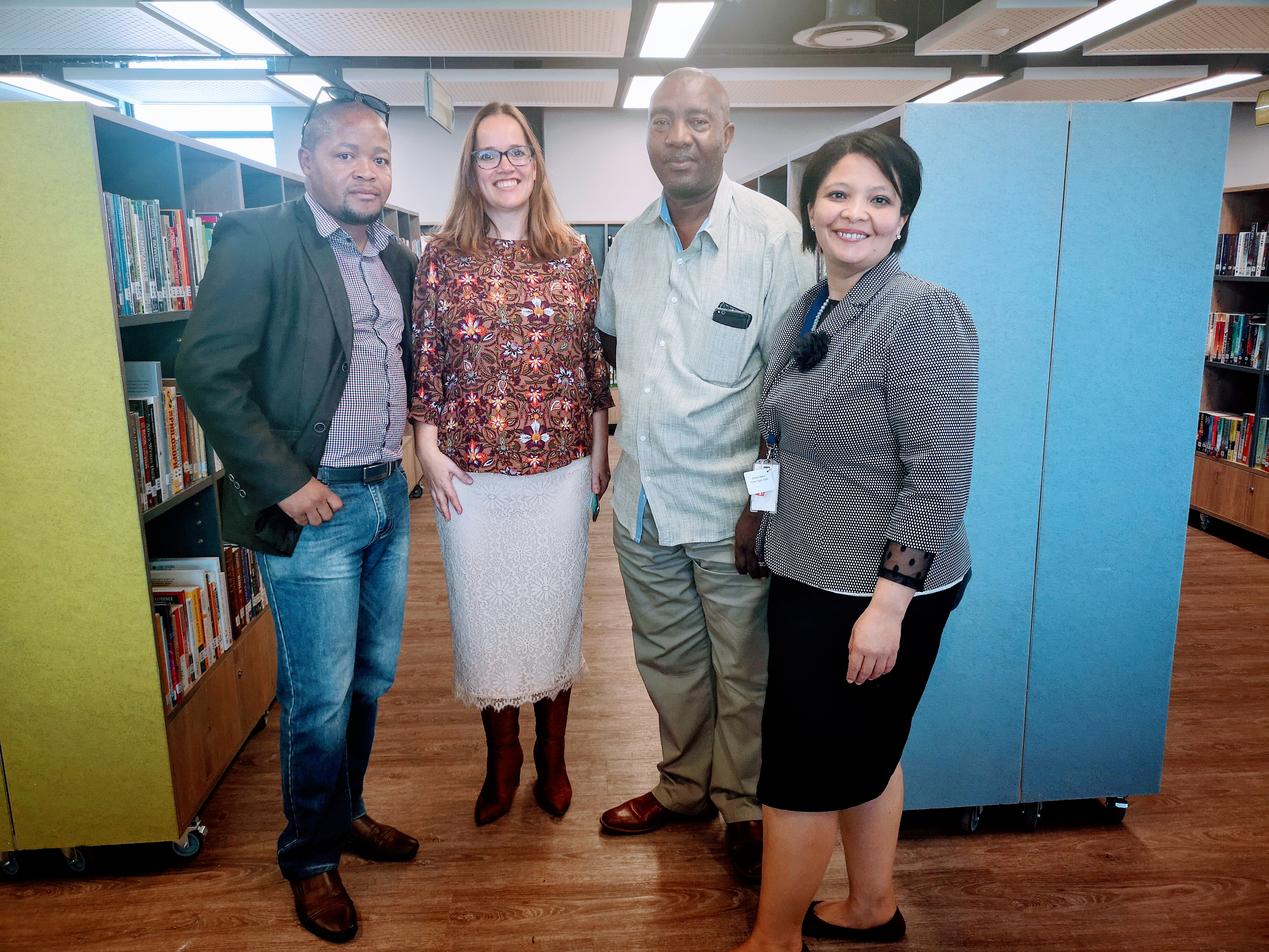 DCAS Director Library Service Cecilia Sani and DAC Provincial Coordinator David Lebelo with Library Service staff at the official opening of the Dunoon Library