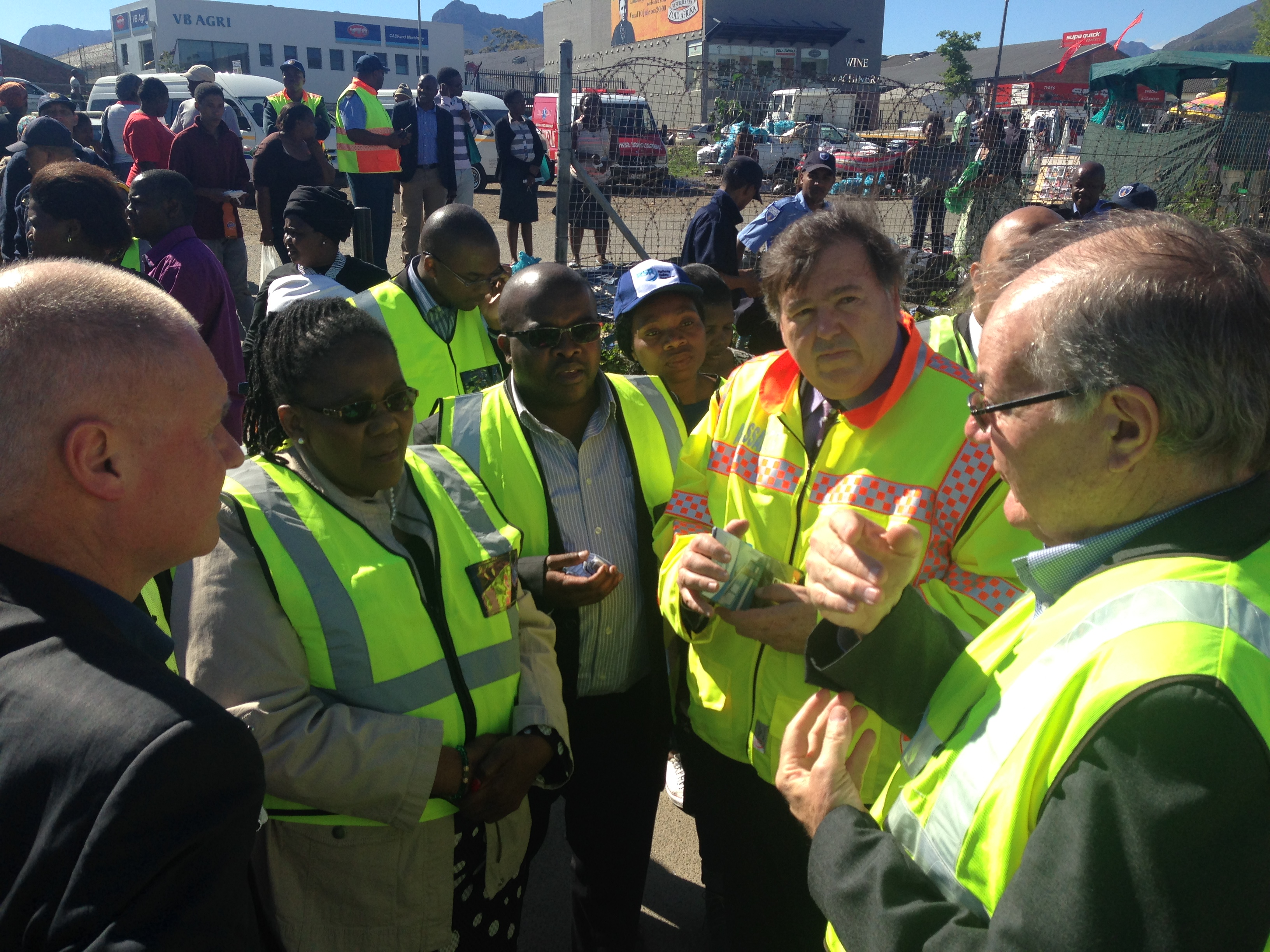 Deputy Mayor Smuts, Minister Peters and Minister Grant with a member of the Railway Safety Regulator at the Kayamandi Level Crossing.