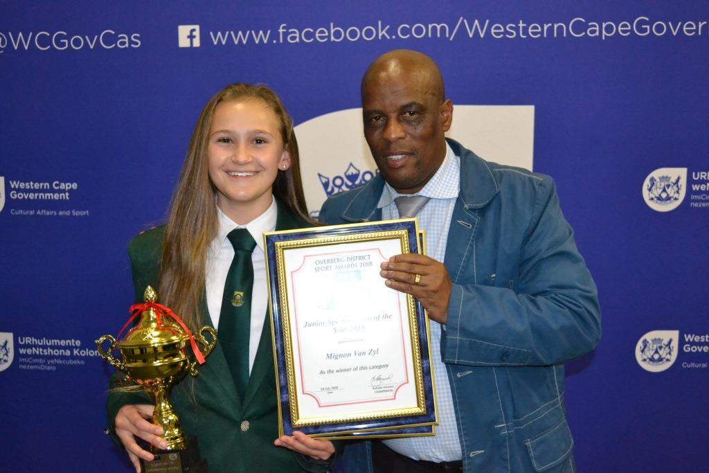 Director Thabo Tutu with junior sportswoman of the year winner Mignon van Zyl at the Overberg Sport Awards