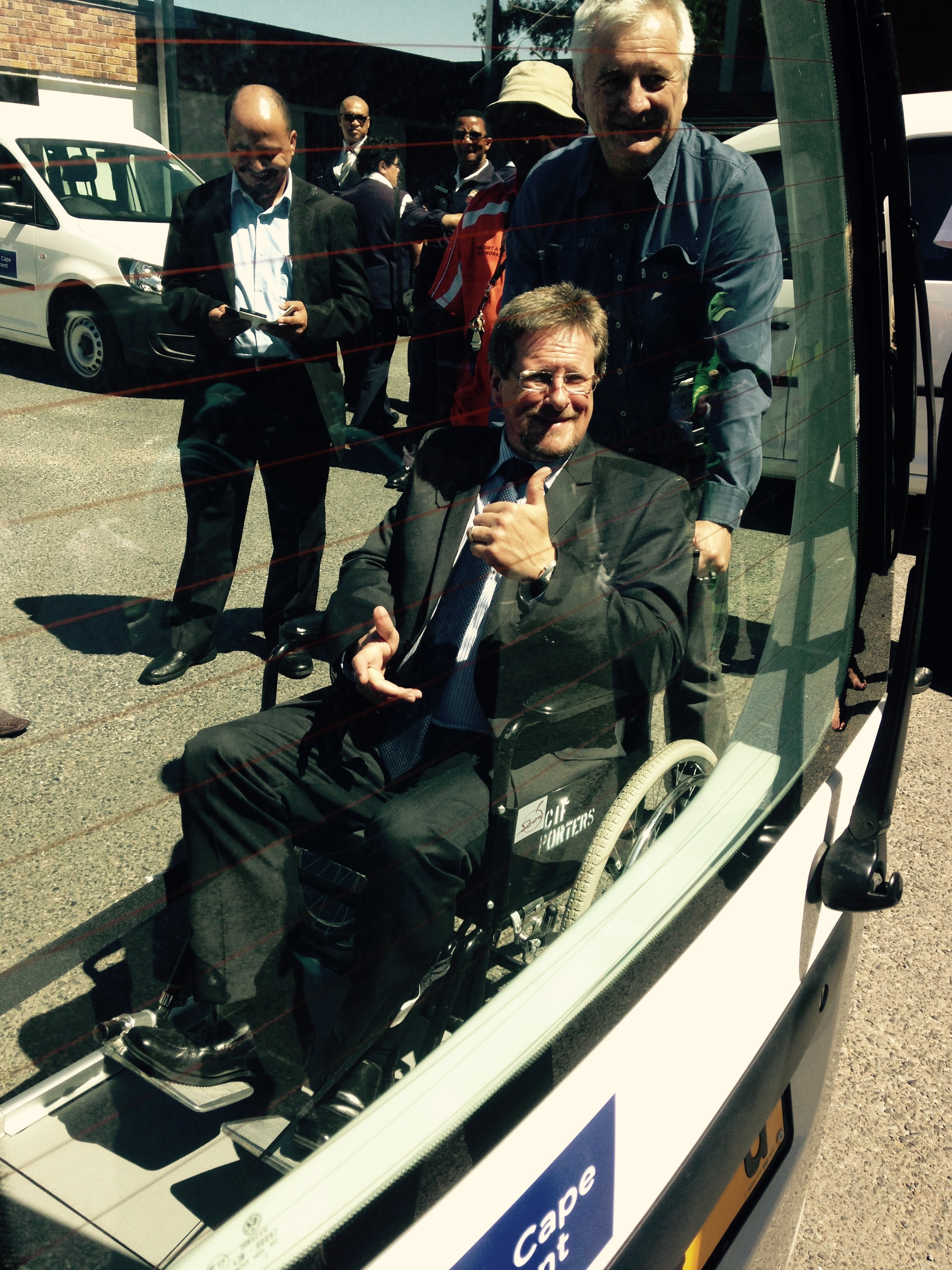 The Western Cape Minister of Health, Theuns Botha, testing the new wheelchair patient transporter that has been added to the HealthNet fleet.