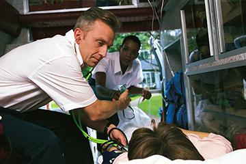 Medic alert patient with health care worker