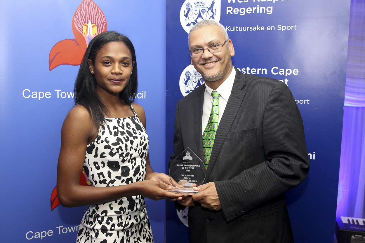 Dr Lyndon Bouah presents Tamzin Thomas with the Junior Sportswoman of the Year award