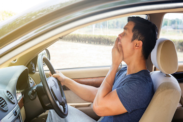 A drowsy man behind the wheel