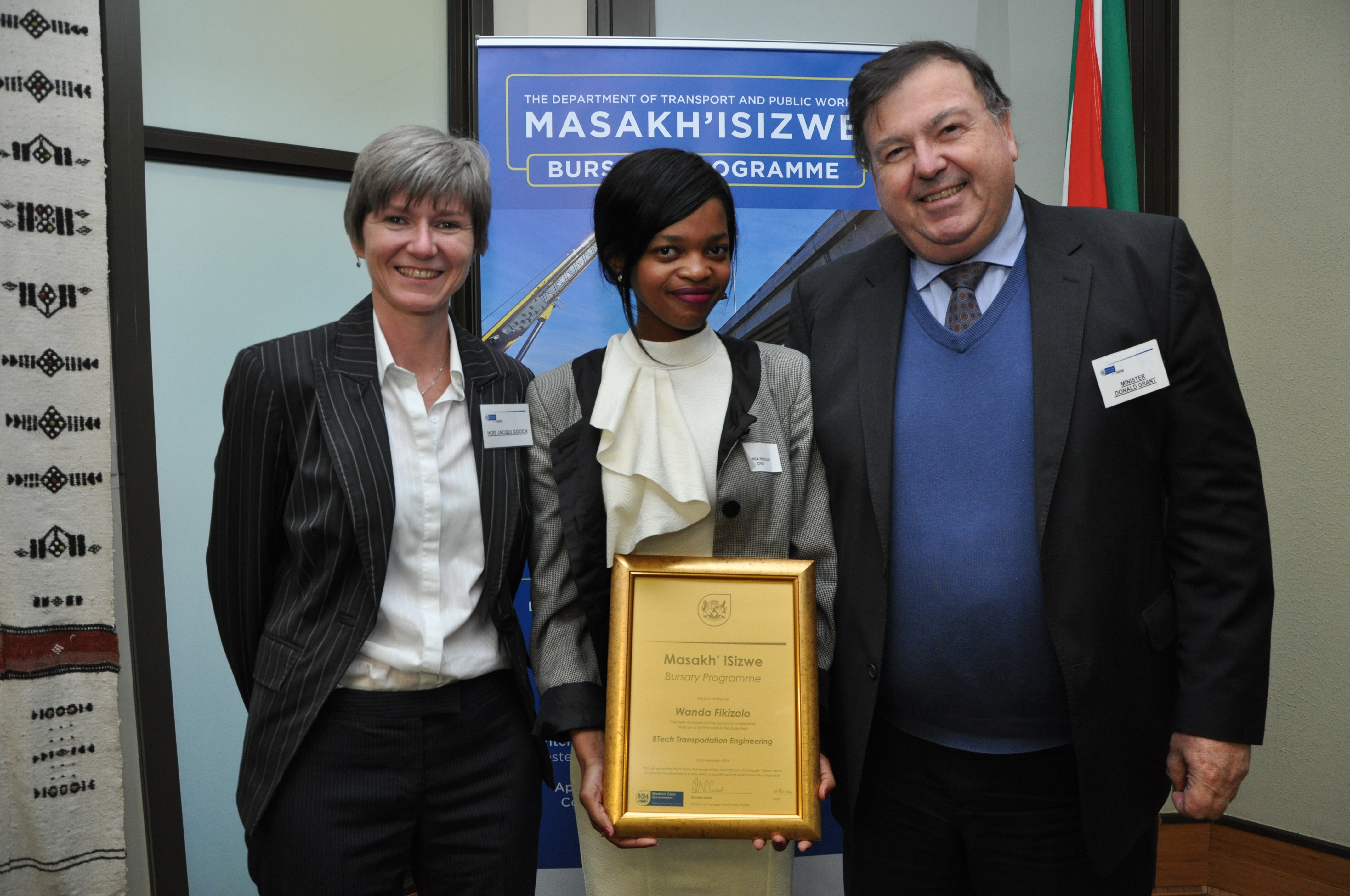 Minister Grant and HOD Gooch with Miss Wanda Fikizolo from Khayelitsha. Miss Fikizolo is currently studying a BTech in Transport Engineering at the Cape Peninsula University of Technology (CPUT).