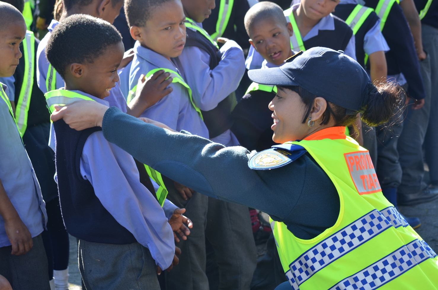 Provincial Inspector Antoinette Fennie hands out reflective sashes.
