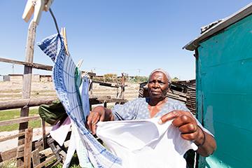 Woman hanging up washing
