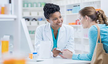 Woman getting medical advice from the doctor about emergency contraceptives.