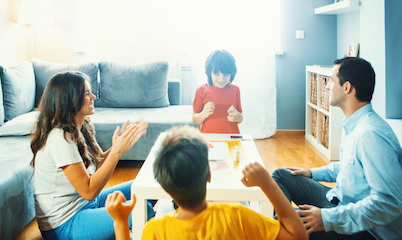 Happy family playing board games