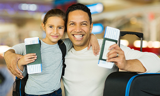 Father and daughter getting ready to board a flight.