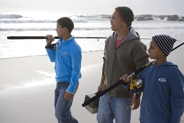 Father fishing with sons