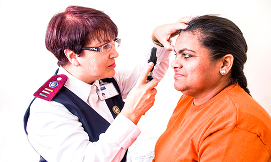 Nurse examining patient.