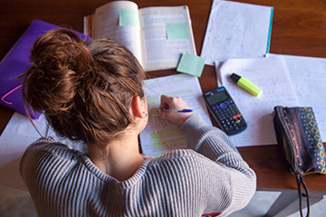Female student studying in her room.