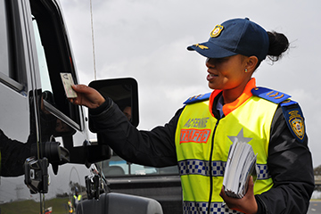 female-traffic-officer-checking-licences