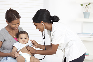 Doctor examining a 6 month old baby boy with stethoscope.