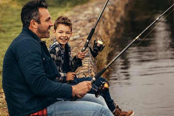 Father and son fishing in the WC