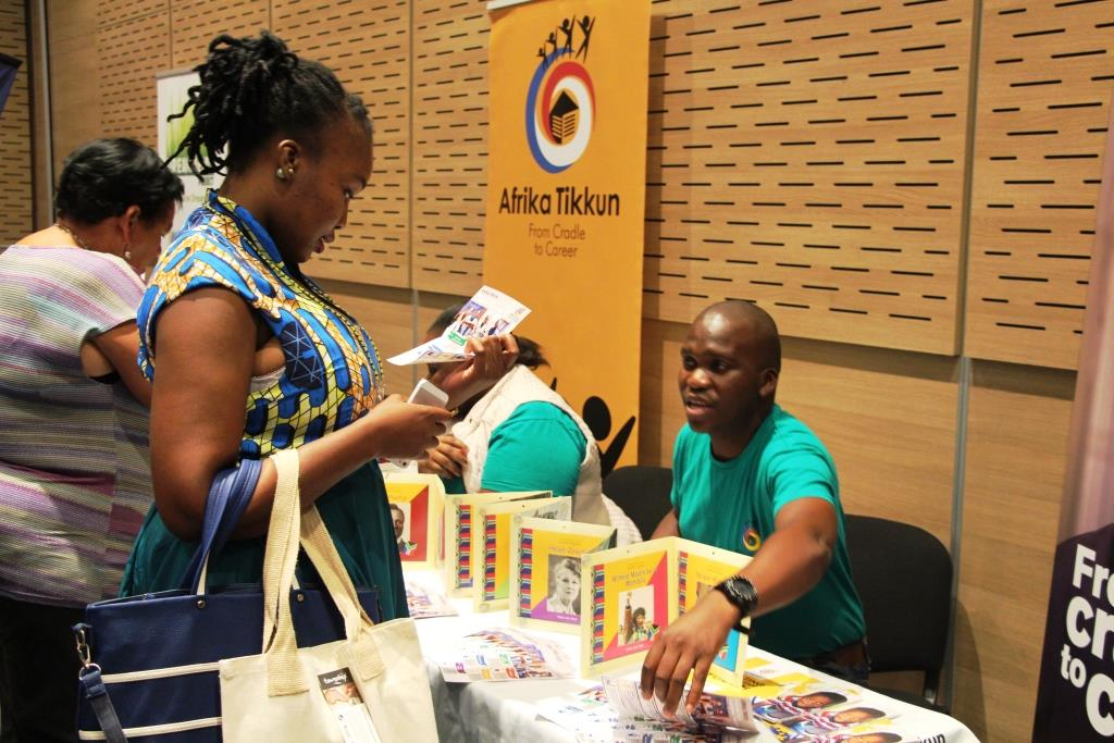 Guests engaging with exhibitors at the marketplace