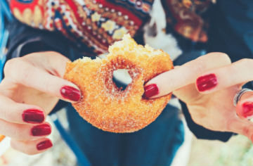 Hands holding a donut