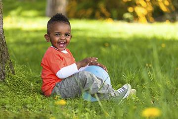 boy sitting on the grass
