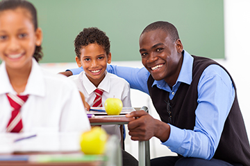 happy-teacher-and-learner-in-class