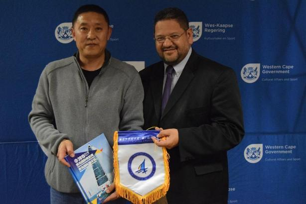 HOD Walters is given a courtesy gift from Wang Yong.