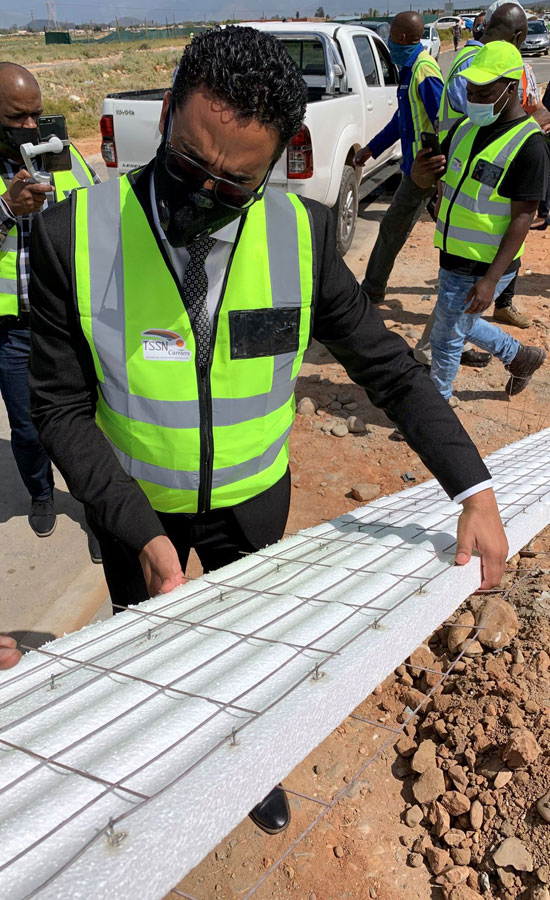 Western Cape Minister of Human Settlements inspecting the SBT material