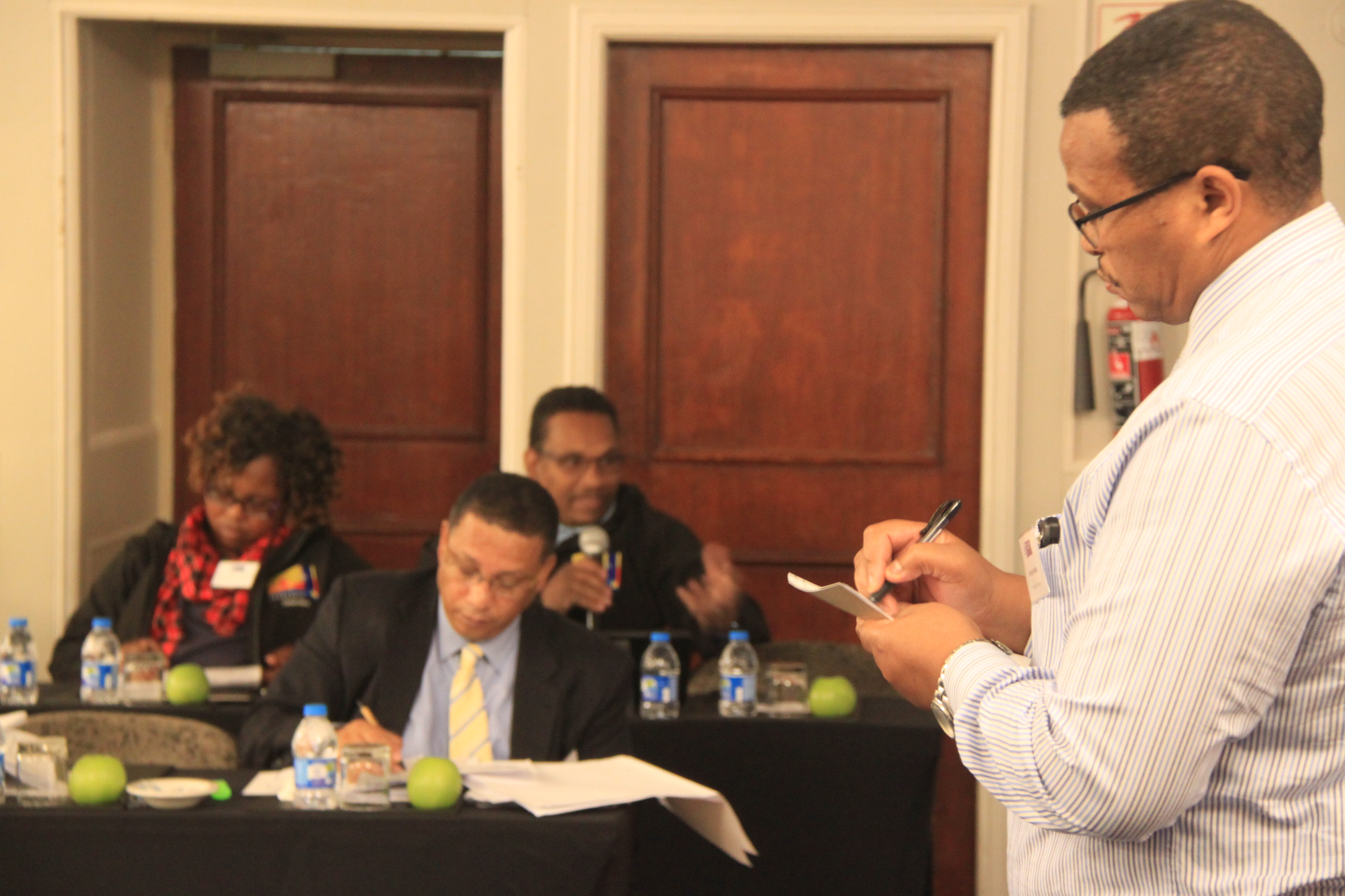 Minister Ivan Meyer (centre) and Mr Harry Malila from the Provincial Treasury during a panel discussion