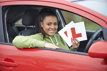 Girl with learner sign