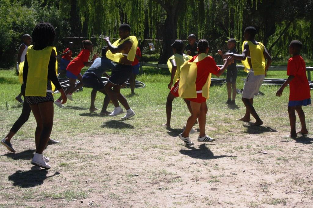 """Learners playing the indigenous Game of """"Drie Blikkies"""""""