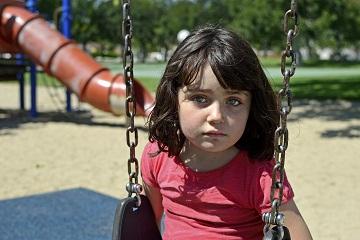little-girl-sitting-on-swing.jpg