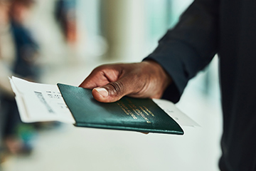 Man presenting his passport at the airport.
