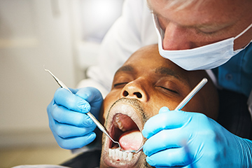 Man visiting the dentist for a check-up.