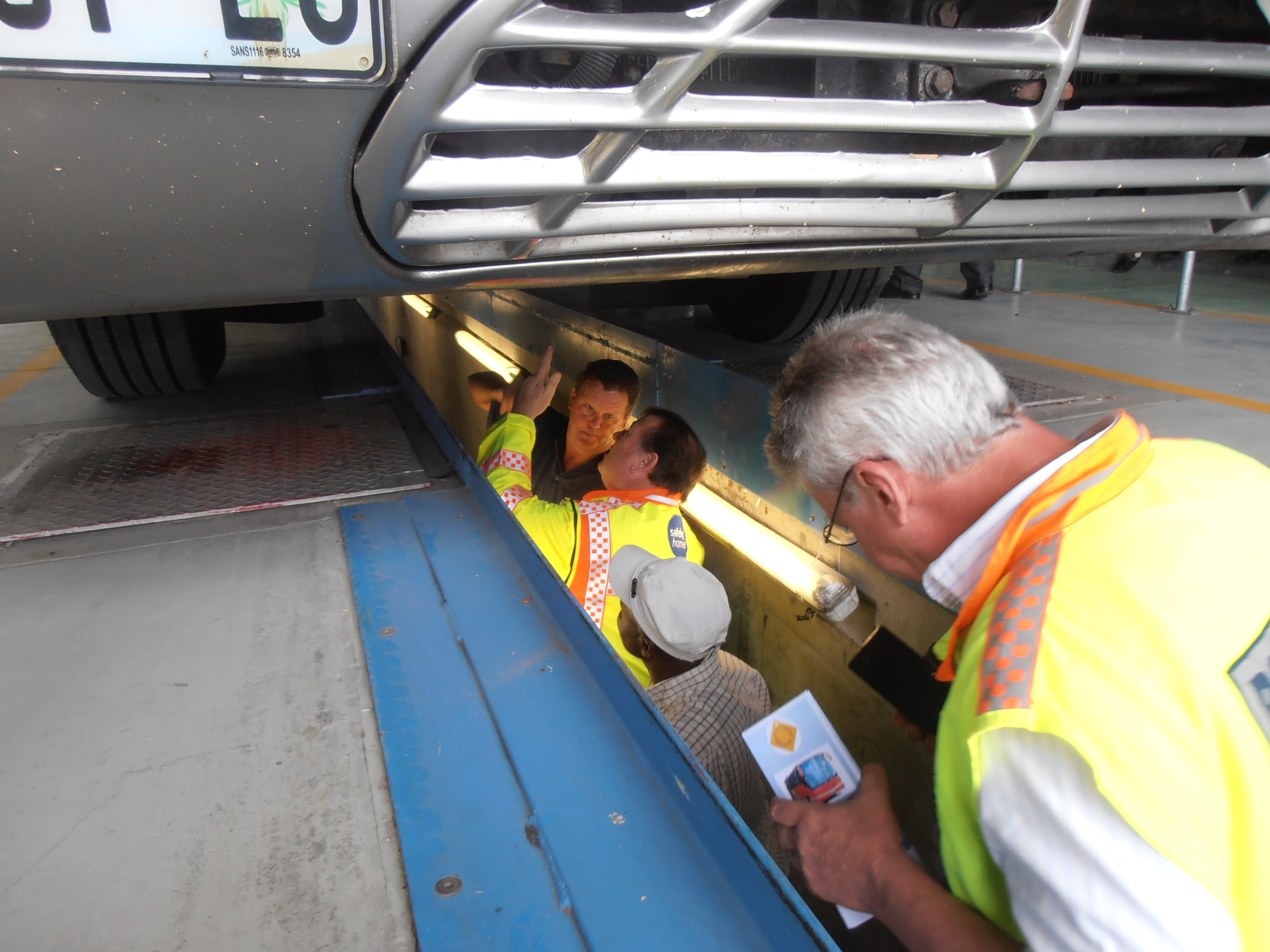 Minister Grant and traffic authorities inspect a bus at the Joe Gqabi Public Transport Interchange as part of the Sticker Project.
