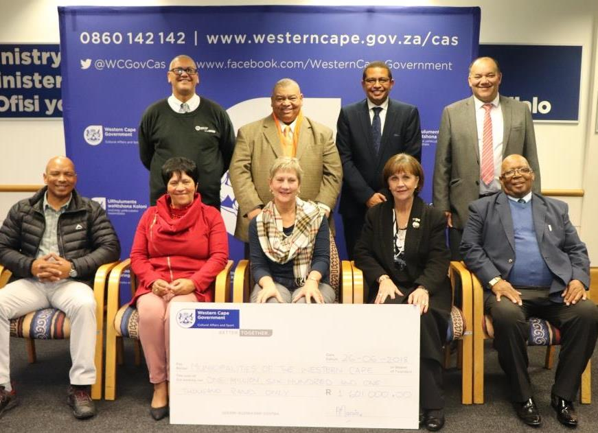 Minister Anroux Marais and Dr Lyndon Bouah with municipal representatives at the cheque handover ceremony in Cape Town
