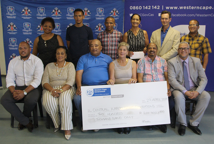 Minister Anroux Marais and Dr Lyndon Bouah with the recipients of sport funding in the Central Karoo