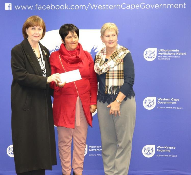 Minister Anroux Marais hands over sport funding to Ald Elize Steyn and Cllr Sucilla van Tura of Saldanha Bay Municipality