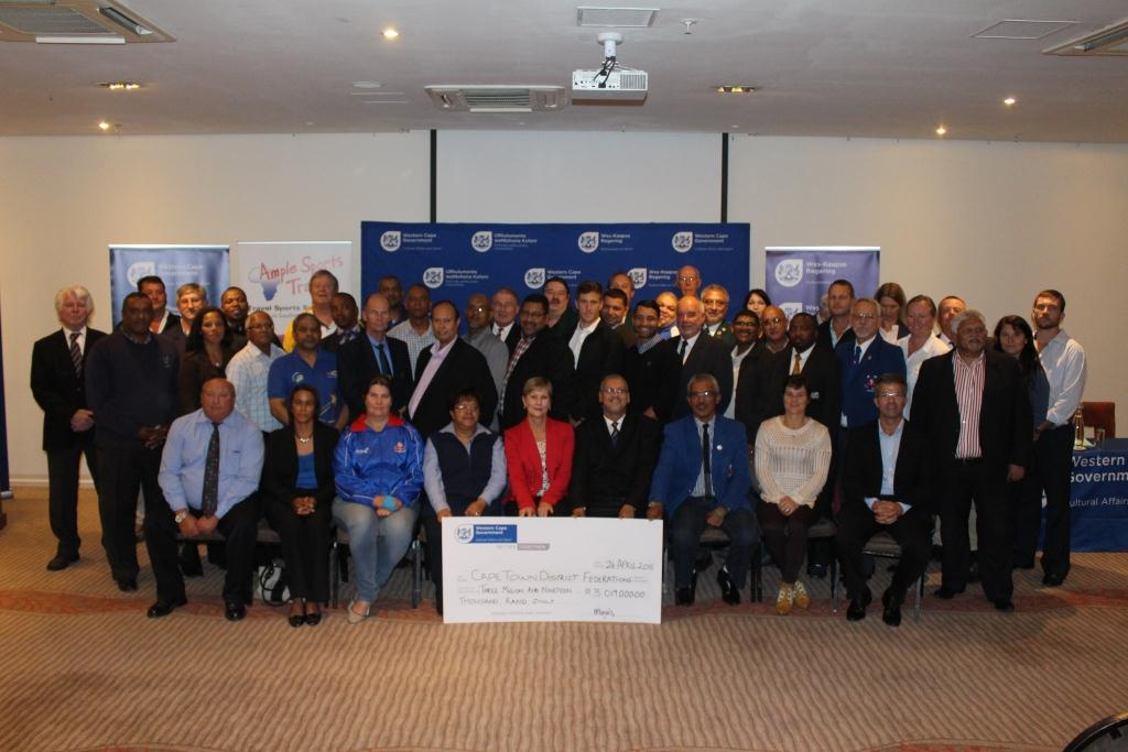 Minister Marais with other DCAS officials and the recipients of the cheque of R3 019 000